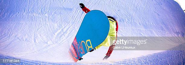 A snowboarder slashes the end of a half pipe August 20 2010 in Snowpark New Zealand
