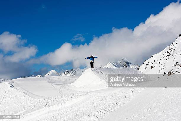 Snowboarder stands on a Kicker