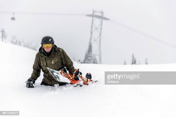 Snowboarder walking in Fresh Deep Powder Snow