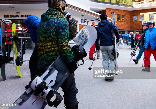Snowboarder with airbrush of former actress Marilyn Monroe on the way to the cableway on the glacier of Hintertux on March 12 2017 in Hintertux...