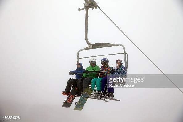 Snowboarders and skiers take the chair lift on July 11 2015 in Mount Buller Australia