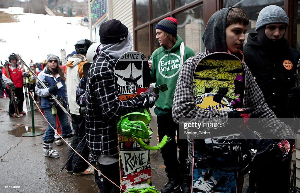 Snowboarders and skiers wait in line for the gondola up Exodus run at Loon Mountain Resort in Lincoln, New Hampshire on November 24, 2012.