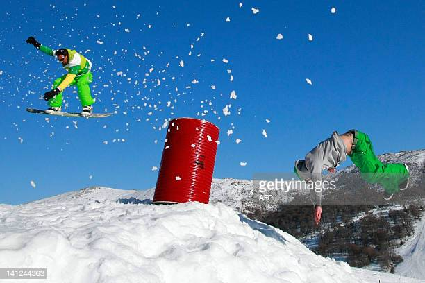 Snowboarders jump in the snowpark in the Val d'Ese ski resort in Bastelica close to Ajaccio in the French Mediterranean island of Corsica on March 3...