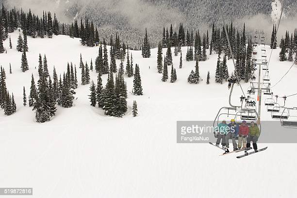 Snowboarders on a ski lift