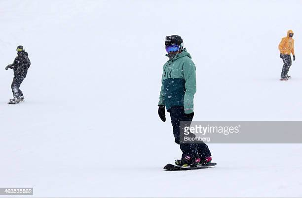 Snowboarders ride down a slope at the Niseko Hanazono resort operated by Nihon Harmony Resorts KK in Kutchan Hokkaido Japan on Sunday Feb 15 2015 The...