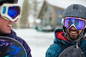 Snowboarders talking in snow