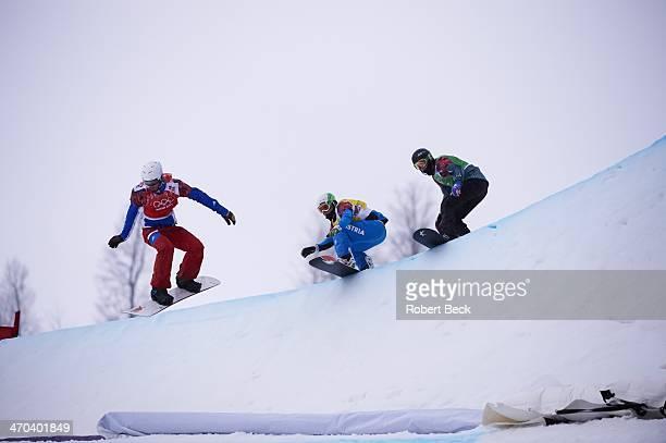 2014 Winter Olympics France Pierre Vaultier Austria Hanno Douschan and Australia Jarryd Hughes in action during Men's Snowboard Cross 1/8 Finals at...