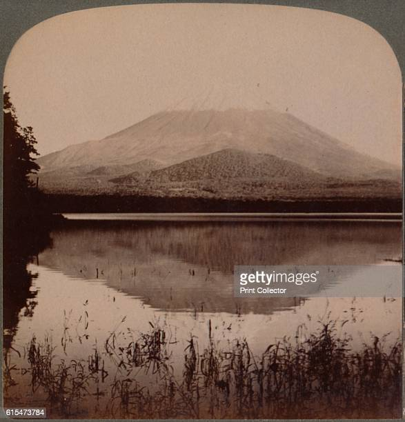 Snowcapped Mount Fuji mirrored in still waters of Lake Shoji Japan' 1904 From The Underwood Travel Library Japan [Underwood Underwood London New York...
