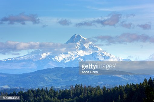 Snowcapped Mount Hood rises above Hood River Valley on spring afternoon, seen from Washington hills