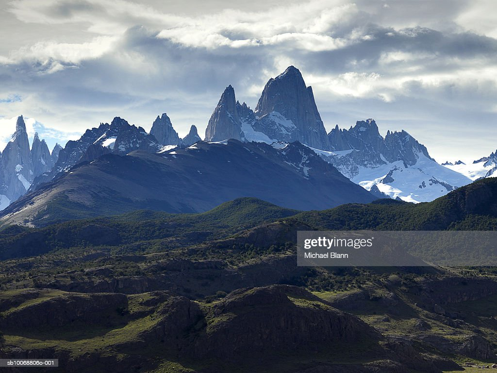 Snowcapped mountains and overcast sky : Stock Photo