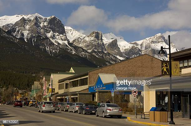 Snowcapped mountains rise dramatically providing a backdrop to this quaint downtown village as seen in this 2010 Canmore Canada spring morning...