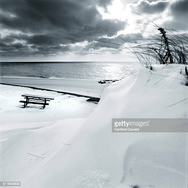 A snowcapped picnic table sits on the beach during sunset at Herring Cove Beach in Provincetown Mass in a 2005 file image While it's technically not...