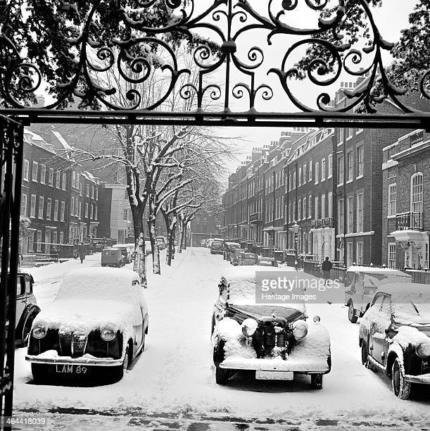 Snowcovered cars Church Row Hampstead London 19601965 A street view in the snow looking east along the middle of Church Row with a row of cars parked...