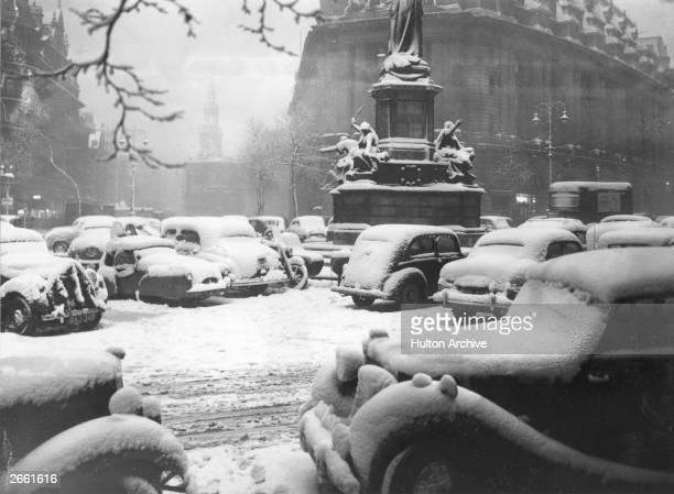 Snowcovered cars parked at the junction of Aldwych and the Strand London