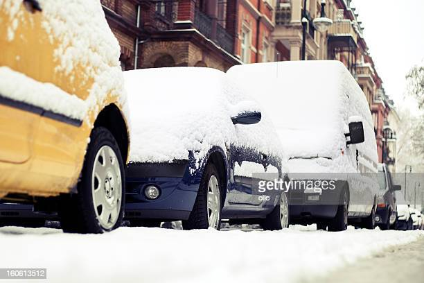 Snow-covered cars