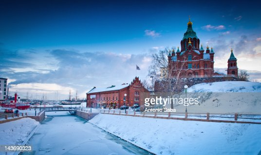 Snow-covered castle by frozen river