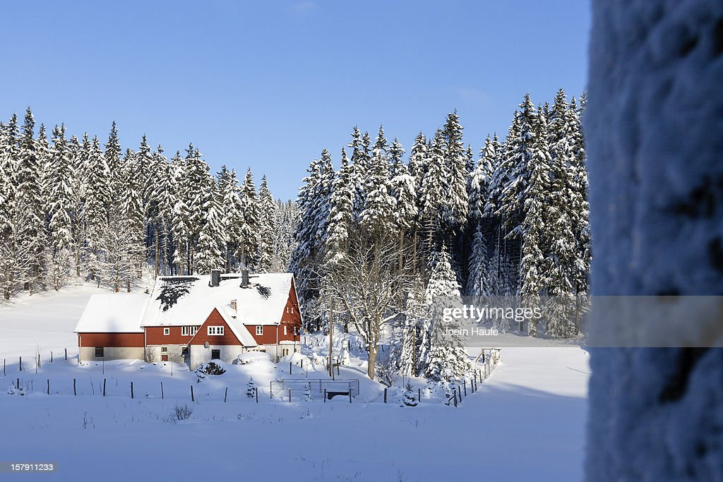 A snow-covered house stands at the forest edge on December 7, 2012 in Hermsdorf, Germany. A low pressure system dumped snow on the south and east of the country before heading west.