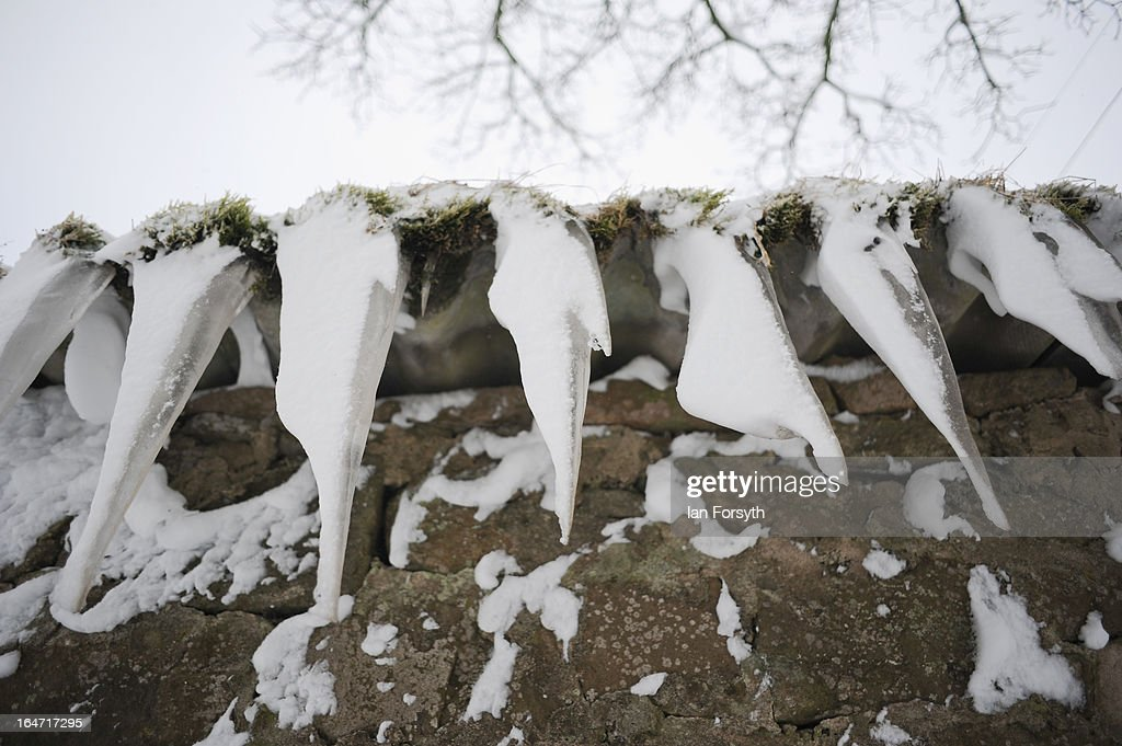 Snow-covered icicles hang from the roof of a house near to the village of Bowes in County Durham on March 27, 2013 in Kirkby Stephen, England. Heavy snow continues to fall in some parts of the country as Britain suffers the coldest March in 50 years.