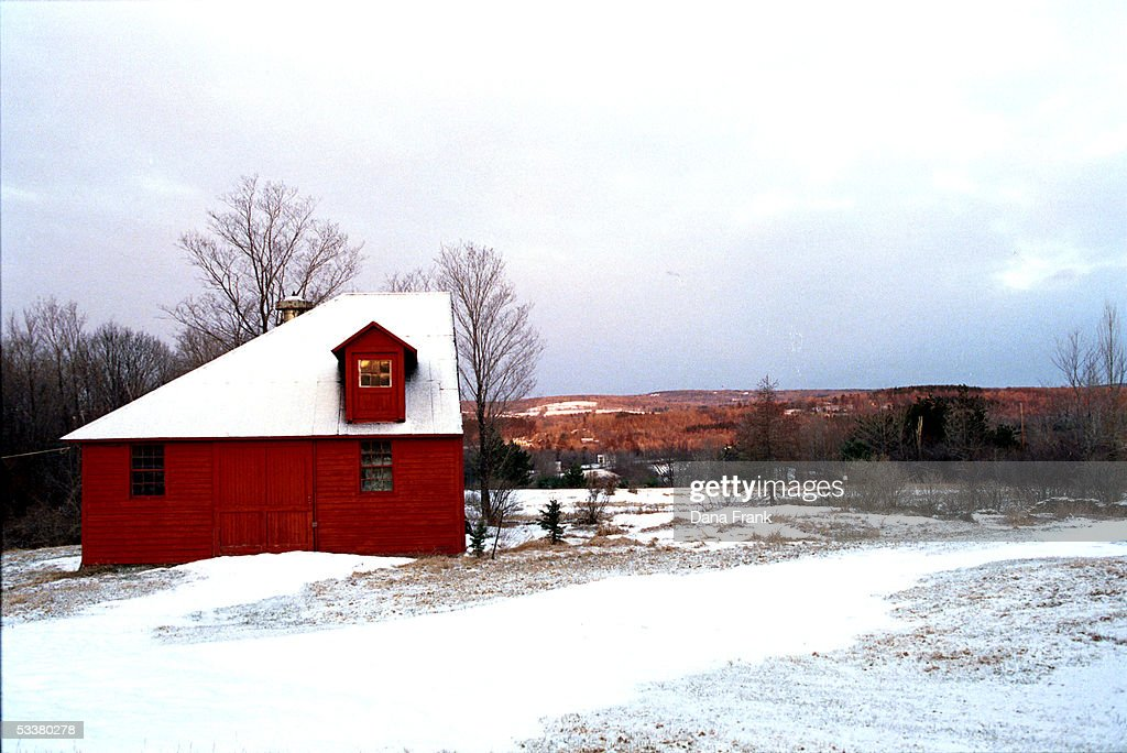 Snowcovered red barn in the Catskill Mountains