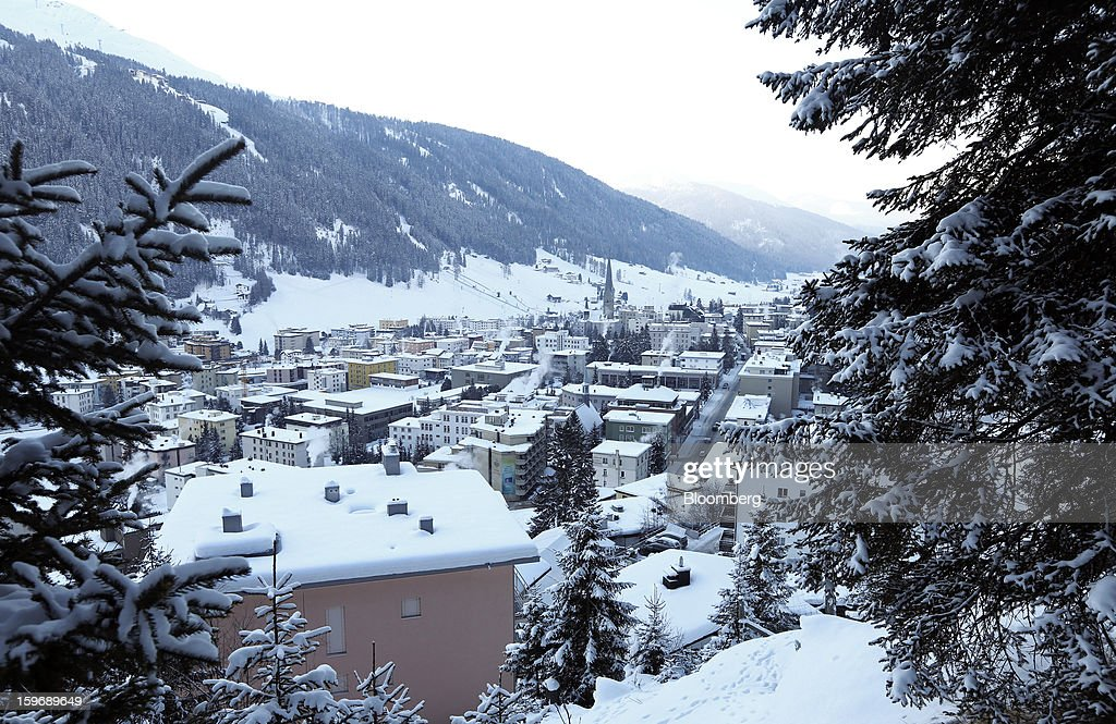 Snow-covered rooftops are seen on residential and commercial buildings in the town of Davos, Switzerland, on Friday, Jan. 18, 2013. Next week the business elite gather in the Swiss Alps for the 43rd annual meeting of the World Economic Forum in Davos, the five day event runs from Jan. 23-27. Photographer: Chris Ratcliffe/Bloomberg via Getty Images