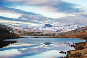Wales, Snowdon, 11 May, 2015 : Snowy Snowdonia mountains in winter .