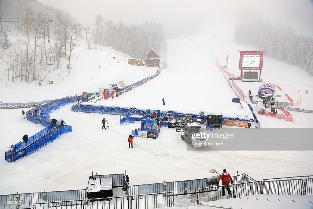 Snowfall obscures the race course as workers remove snow in the base area as downhill training for the Birds of Prey Audi FIS Ski World Cup was cancelled due to excessive snow on December 4, 2013 in Beaver Creek, Colorado.