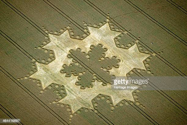 'Snowflake' crop circle near Alton Barnes Wiltshire 1997 Some people regard crop circles as evidence of UFO contact or spiritual activity Others...