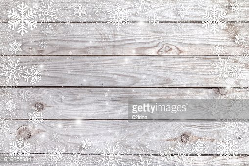 Snowflakes on a wooden background. : Foto de stock