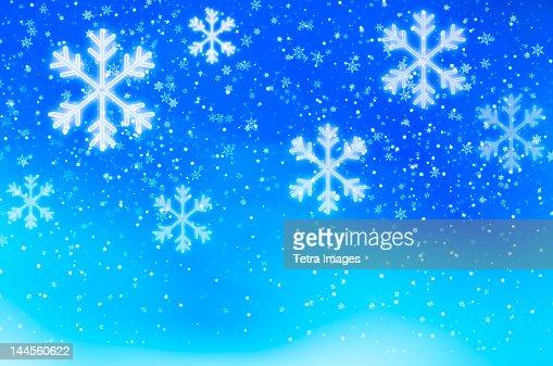 Snowflakes on blue background, studio shot