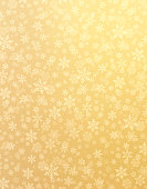 Snowflake shapes on a shiny gold background