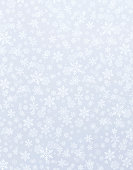Snowflake shapes on a shiny silver background