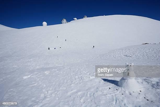 Snowman and astronomical telescopes at Mauna Kea