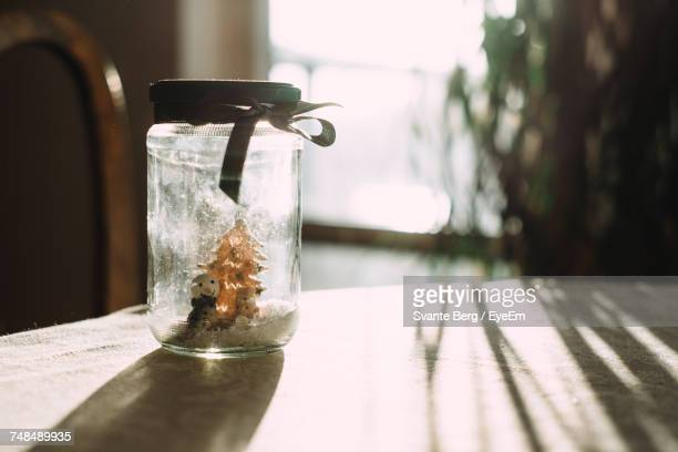 Snowman And Christmas Tree In Jar On Table