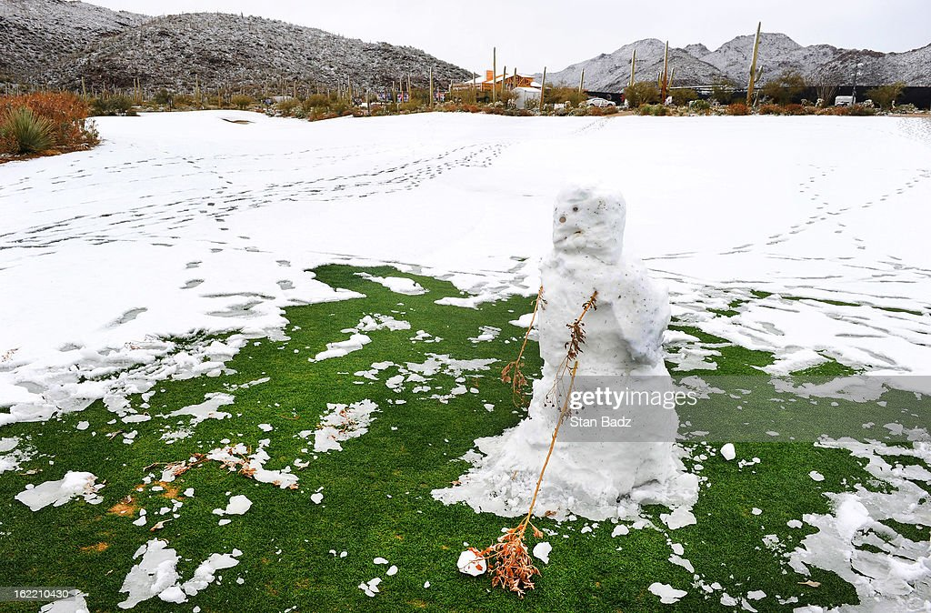 A snowman hitting a golf ball is seen on the course as snow and rain caused play to be suspended due to weather during the first round of the World Golf Championships-Accenture Match Play Championship at The Golf Club at Dove Mountain on February 20, 2013 in Marana, Arizona.