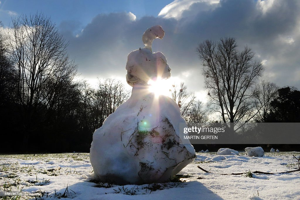 A snowman melts in a park in Duesseldorf, western Germany, on December 11, 2012. Temperatures were slightly above the freezing point.