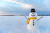 snowman on orange sunset background