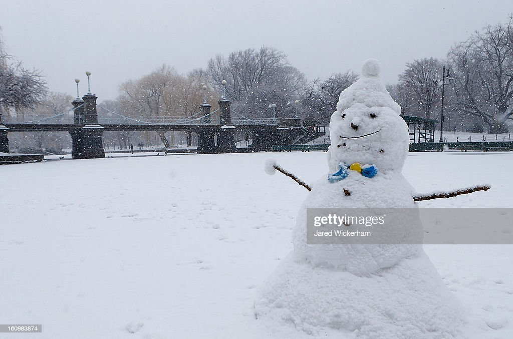A snowman sits on the duck pond in the Boston Common as snow falls on February 9, 2013 in Boston, Massachusetts. Massachusetts and other states from New York to Maine are preparing for a major blizzard with possible record amounts of snowfall in some areas.