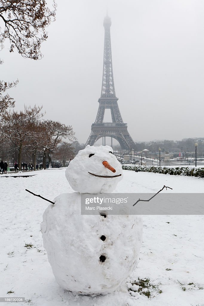 A snowman stands near the Eiffel Tower on January 19, 2013 in Paris, France. Heavy snowfall fell throughout Europe and the UK causing travel havoc and white layers of pretty scenery.