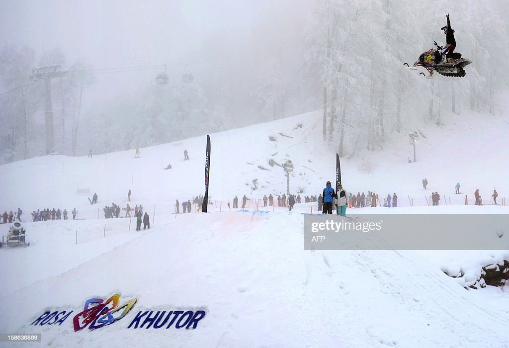 A snowmobile rider jumps on December 22, 2012 at the Rosa Khutor Mountain Resort in Krasnaya Polyana outside the Russian Black Sea resort of Sochi. AFP PHOTO / MIKHAIL MORDASOV