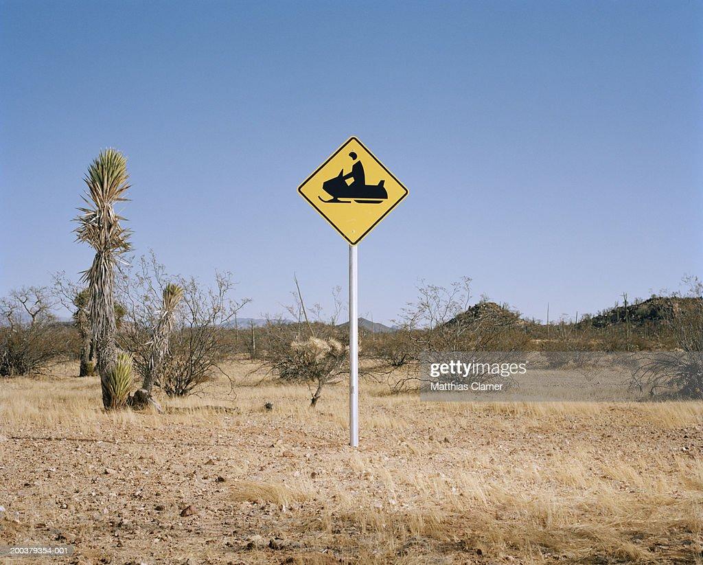 Snowmobile warning sign in desert : Stock Photo