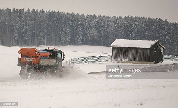 A snowplough clears a snowcovered road near the ham of Issing on January 23 2007 in Bavaria Southern Germany After warmer temperatures than usual in...