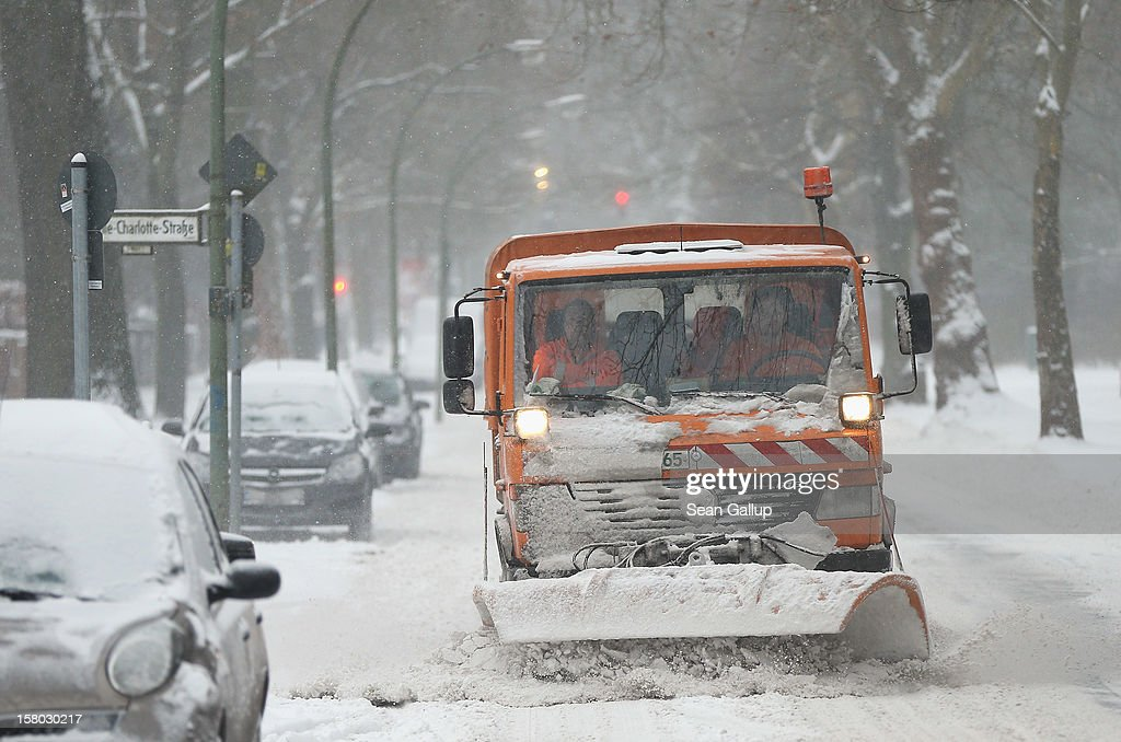 A snowplough clears snow from a street after a heavy snowfall in Zehlendorf district on December 9, 2012 in Berlin, Germany. Northeastern Germany was inundated with snow that covered highways and blanketed the region.