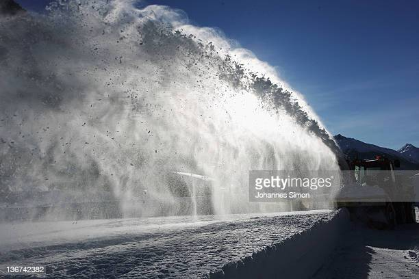 A snowplough removes snow from the surface of the local ice rink stadium on January 11 2012 in Ischgl Austria In the last week heavy snowfalls have...