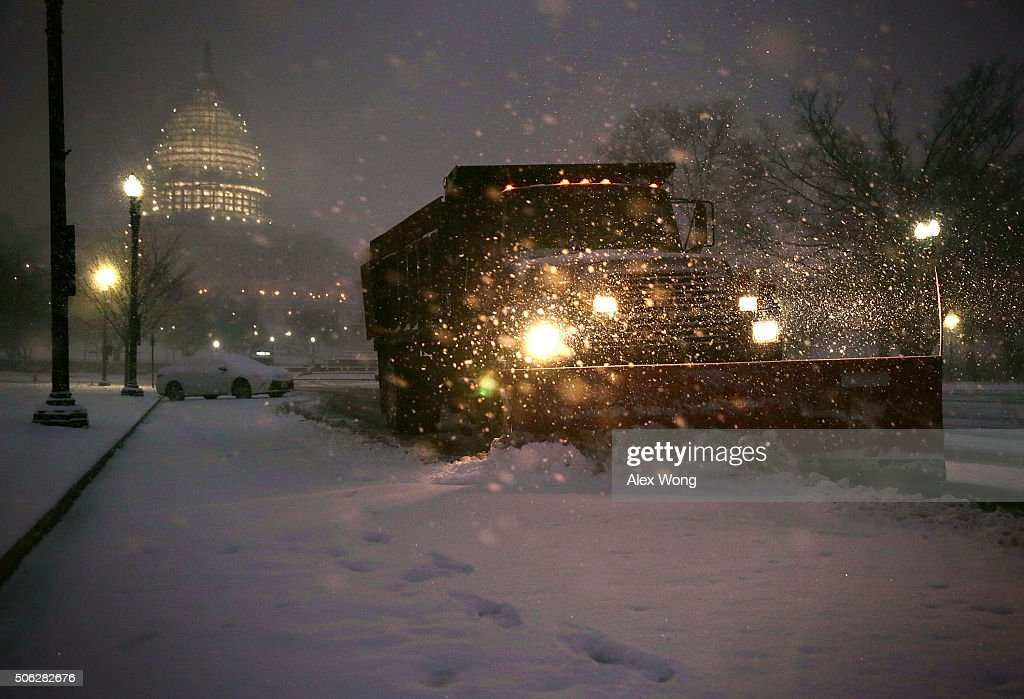 A snowplow cleans up snow on Pennsylvania Avenue in front of the US Capitol January 22 2016 in Washington DC A winter snowstorm is forecasted for the...