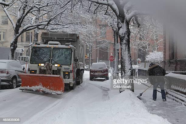 Snowplow clears narrow Brooklyn Heights street