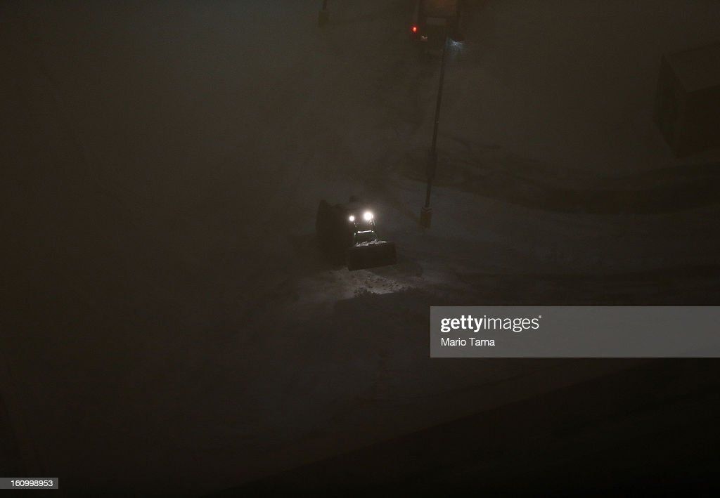 A snowplow operates in the Back Bay neighborhood on February 8, 2013 in Boston, Massachusetts. Massachusetts as well as other states from New York to Maine are preparing for a major blizzard with possible record amounts of snowfall in some areas.