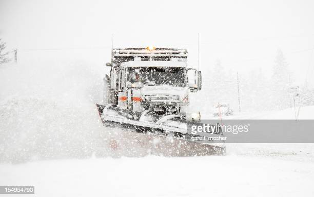 Snowplow Plowing Highway During Large Winter Storm