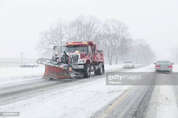 Snowplow Truck Working During Blizzard