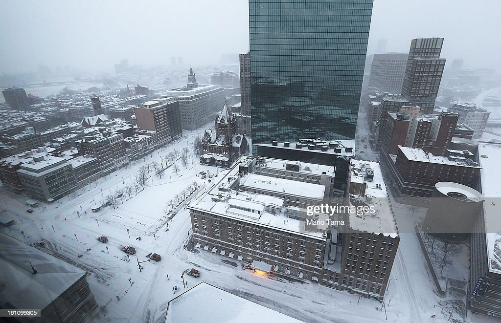 Snowplows (lower left) move past Copley Square during a blizzard on February 9, 2013 in Boston, Massachusetts. The powerful storm has knocked out power to 650,000 and dumped more than two feet of snow in parts of New England.
