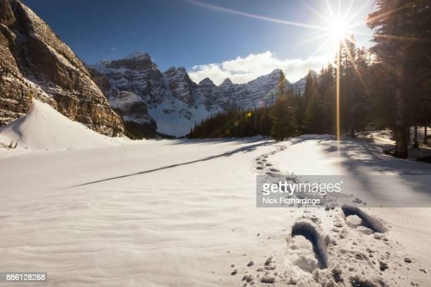Snowshoe tracks at a deserted Moraine Lake, Alberta, Canada